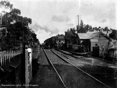 Steam Train from Mentone at Cheltenham just before Charman Road Crossing, Gate Keeper's Cottage to right [picture].