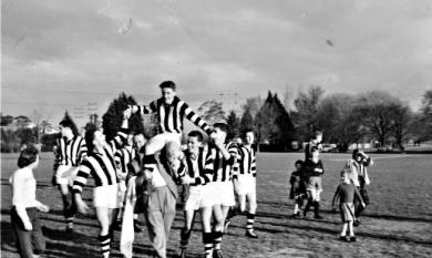Leo Gamble captain of the Mentone CYMS team, being 'chaired' off after a semi-final win in 1957 [picture].