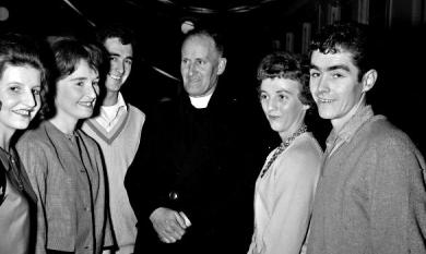 Father G Quilter parish priest of St Agnes Catholic Church Highett with some young parishioners [picture].