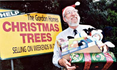 Bob Flavell of Gordon Homes selling Christmas trees [picture].