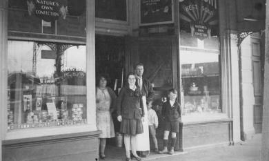 Robins Store shopfront with Robins family members [picture].