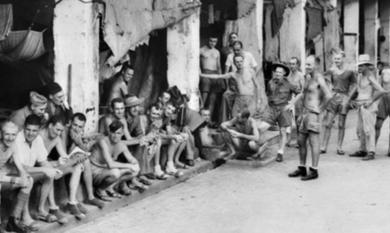 Batavia Java, 1945. A group of Australian and British Troops until recently Prisoners of War. The Australians in this group are members of 'Black Force' [Picture].