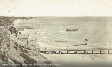 Mentone Beach, Seagull Rock and piles of Old Baths in distance, c1920 [picture].